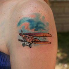 Custom plane tattoo