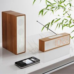 Designed by Jeremy & Adrian Wright  A bamboo bluetooth speaker and radio alarm.