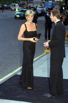 JULY 1997 - Diana arrived at the Tate Gallery to celebrate the centenary of the museum – as well as her own birthday. She wore a full-length black beaded dress with an emerald Queen Mary choker for the occasion.