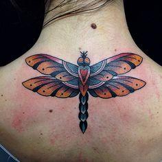 Neo traditonal dragonfly tattoo