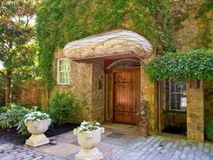 Stone house with beautiful wood and iron door.    5837 Nw Skyline Blvd Portland, OR 97229 - Portland Homes | Hasson Company Realtors