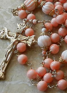 This is a rosary I made in 14K gold with 7mm angelskin coral and large 10mm hand-carved angelskin coral Our Father beads.  rosary. www.queenofpeace-rosaries.com