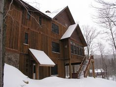 Darkly stained cedar board & batten siding looks dramatic against pure white snow. from Western Red Cedar Lumber Association Cedar Siding, Exterior Siding, Tin Siding, Exterior Paint, Red Cedar Lumber, Hickory House, Homestead House, Board And Batten Siding, Hillside House