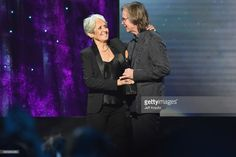 Inductee Joan Baez (L) and Presenter Jackson Browne appear onstage at the 32nd Annual Rock