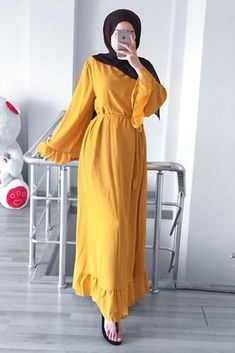 Look like a doll in our Dorothy dress! Frills on dress hem and waist Hand tie belt Approx length: One Size: fits UK regular Machine washable Available in two colours: Stone & Mustard Hijab Fashion Summer, Modest Fashion Hijab, Modern Hijab Fashion, Hijab Style Dress, Hijab Fashion Inspiration, Abaya Fashion, Fashion Dresses, Hijab Outfit, Hijabi Gowns