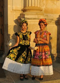 Sunset Women Oaxaca Mexico | The setting sun illuminates two women dressed in the style of the Istmo de Tehuantepec.  Oaxaca, Mexico