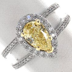 This luxurious design features a fancy yellow pear shape diamond center held in place with 18 karat yellow gold prongs. This 1.00 carat pear cut stone is surrounded by a scintillating micro pavé halo. #knoxjewelers #ring  www.knoxjewelers.biz