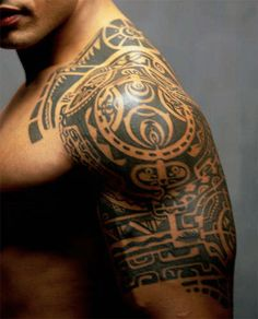 Traditional Polynesian shoulder and upper arm tattoo.