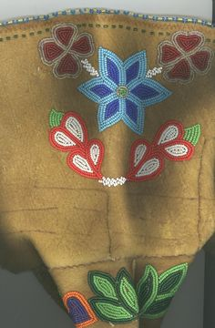 Metis Beadwork: Beading patterns and designs from the Louis Riel Institute archive.Flower beadwork.