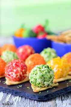 This easy appetizer recipe for Veggie Pizza Bites has mini roasted garlic cheese balls coated with chopped veggies on a pita cracker.