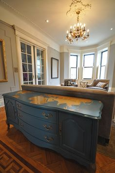 nice idea- to add in gold the map look to an out of date chest of drawers after painting it.