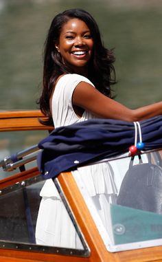Gabrielle Union is all smiles in a lovely white dress. #fashion