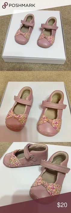 Toddler Girl Clark's Pink Floral Bow Mary Janes Adorable light pink leather like style with Velcro strap closure at ankle for quick & easy  on/off for your little toddler on the go! Super comfy in true Clark's fashion/style, topped off with an adorable little floral bow & supportive rubber soles & rubber toe bumper so your tot can walk in comfort. Gently worn,light signs of wear Clarks Shoes Baby & Walker