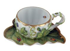 Amazing hand painted tea cup by Anna Weatherley.  I love the little beetle inside the cup.