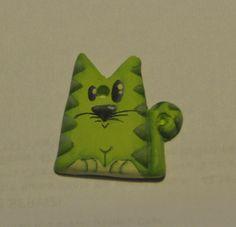 https://littlehats.files.wordpress.com/2011/04/gattino_verde.jpg