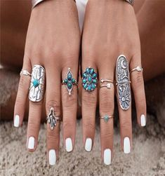 Boho ring set includes all nine rings shown! Set has two long totem shields, one has cactus, the sun, a longhorn skull and a crescent moon, the other has a squa
