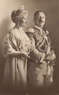 "Kaiser Wilhelm II (1859-1941) & 1st wife Auguste Victoria ""Dona"" (1858-1921) on a German Postcard by T. Voigt in 1910. Auguste died shortly after word came of the suicide of her beloved son Joachim (1890-1920).  Her body was sent back to Germany for burial the Kaiser having to say his last farewell at the Dutch border & even in the new republican Germany her loss was an occasion of great mourning."