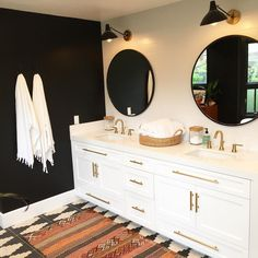 """""""So beyond thrilled to share this awesome black and white bohemian bathroom. The black wall worked out and I love the special fringe towels from @503found.…"""""""