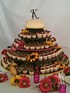 Cheesecake wedding tower-- we always said we wanted to have cheesecake for our wedding! Cute with different accent decorations too.