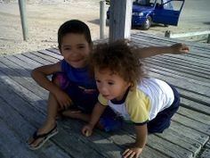 Cohen & Cai sitting on the the dock of the bay