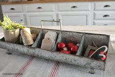galvanized metal carrier used as a holder for gift wrapping supplies