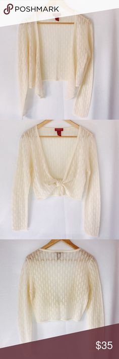 "Sundance Cashmere Cream Ivory Crop Tie Cardi Shrug Ivory/ light cream/winter white color open front tie cropped cardi / shrug.  100% cashmere.  In excellent condition. No stains, holes or tears.   Pretty loose open weave knit.  Lightweight.   Pit to pit laying flat 17.5"", length 17"".  From Robert Redford's Sundance catalog. Sundance Sweaters Cardigans"