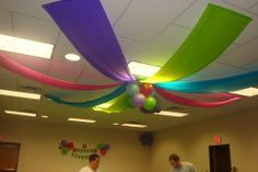 Plastic tablecloths. This would be cute on the ceiling in the classroom if the pinatas aren't in the way...