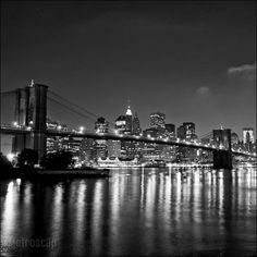 """Black and White photo of the New York City Skyline From Brooklyn in 2005. As Framed 12"""" x 12"""" print."""