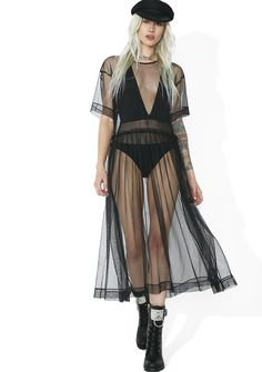 Last Dance Sheer Mesh Midi Dress yew keep the party goin' till the sun comes up! This dress features a sheer mesh construction, round neckline, short sleeves, and a flowy gathered midi length skirt.