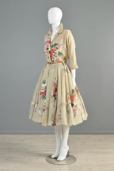 1950s Holly Hoelscher Hand-Painted Silk Chiffon Party Dress. Button front with 3/4 sleeves, nipped waist, and full skirt. Sheer silk chiffon with huge one-of-a-kind hand-painted bouquets - every grouping is different! Fully lined in silk. Via Bustown Modern.