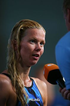 Britta Steffen of Germany speaks to the media after competing during the Swimming Women's 100m Freestyle preliminaries heat six on day thirteen of the 15th FINA World Championships at Palau Sant Jordi on August 1, 2013 in Barcelona, Spain.