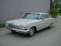 1962 Chevrolet Impala 4 DOOR SEDAN V8, AUTO - This is the first car I remember our family owning as a child. On long rides I would lay up in the back dash.