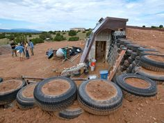 This is more than a house; it's an Earthship: an off-grid passive solar adobe, … Earthship Biotecture, Earthship Home, New Santa Fe, Drought Resistant Landscaping, Thermal Mass, Eco Architecture, Passive Solar, Living Off The Land, Earth Homes