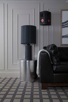 Farrow & Ball's Elephants Breath covering the walls, ceiling, and trim helps blur the lines between the walls and the low ceilings and create warmth while still feeling open and light.