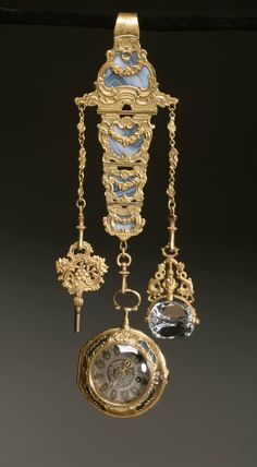 Chatelaine: The chatelaine is fitted with a watch key, fob watch and a revolving rock crystal seal, neither of which were likely made at the same time as the chatelaine and watch.  Date	18th century  Medium:	gold, gilt metal, agate, rock crystal Wikimedia Commons