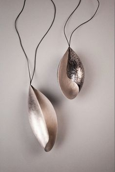 Ingjerd Hanevold: Music of the sphares, 2012. pendants, silver and ox silver, cotton.  Photo Andi C. Andreassen