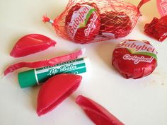 Babybel Lip Balm ! Heat and melt the wax from one mini babybel cheese (red or yellow) with 1 teaspoon grapeseed oil. You may add powdered colouring to use as lipstick.