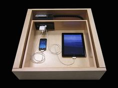Above: In-drawer outlets in entry credenzas are convenient for charging personal electronics. They can be configured by an electrician or are available preconfigured from Docking Drawer.