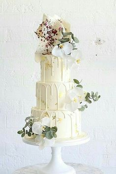 36 Drip Wedding Cakes Almost Too Pretty To Eat - White drip wedding cake with flowers. #dripcake #weddingcake