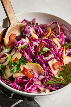 This quick and easy 20-minute cabbage and apple slaw recipe incorporates bacon, cabbage, apples, onions and parsley to create the ultimate fall recipe. Whether you're looking to eat this apple recipe as a snack, side dish, light lunch, appetizer or alongside a pork recipe, it's a great choice for an apple recipe.#applerecipes #slawrecipes #coleslawrecipes #fallrecipes #porkrecipes #sidedish