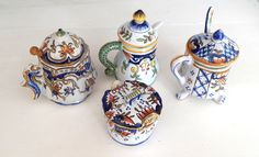4 Vintage French Porcelain Mustard Pots Desvres by Vintagefrenchlinens on Etsy https://www.etsy.com/listing/236316662/4-vintage-french-porcelain-mustard-pots