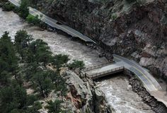 The Big Thompson River floods and damages Highway 34 in the Big Thomspon Canyon west of Loveland Friday September 13, 2013.