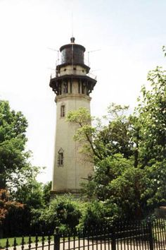 Staten Island Light, NY; This lighthouse serves as a rear range beacon in tandem with the West Bank Lighthouse. Today only half of the original bivalve second order Fresnel lens is in use. The keeper's house now serves as a private residence. This lighthouse also has a light mounted on its gallery that serves as the Swash Channel Range Rear Light.