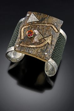 Cuff | Bond Blackman. Sterling silver, Green sting ray skin, Autumn topaz, 10k gold, Mokume gane and a large piece of 10 thousand year old Mammoth Ivory.