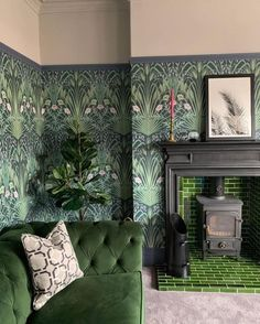 This beautiful Cole and Son wallpaper really makes a statement in this sitting room. This beautiful Cole and Son wallpaper really makes a statement in this sitting room. Living Room Green, Green Rooms, Living Room Sets, Fireplace Hearth Tiles, Art Deco Fireplace, Cole And Son Wallpaper, Sage Green Wallpaper, Green Floral Wallpaper, Green Velvet Sofa