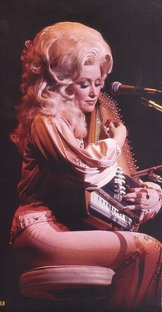 Dolly Parton with an autoharp and BIG hair