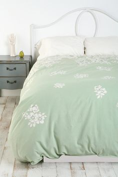 love the color.  this would look good in my beige bedroom.  Falling Floral Duvet Cover $79