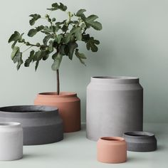 """""""Arrange your plants in our minimalistic pots with geometric details."""" The pots are made of concrete and are suitable for both indoor and outdoor use."""