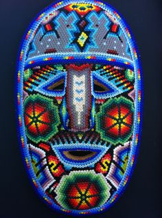 HUICHOL BEADED MASK. via Etsy.