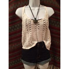 ROXY Bohemian Top Excellent condition. Worn/washed once. The flower design is made to look loose, but only a FEW flowers throughout have a string that's looser than the rest. Pair this with a bandeau and some flowy palazzo pants or high rise shorts. Long crop top. ••• Torso in Front length: 14in from start of crotchet at shoulder to bottom. Back length: 19in from top of crotchet to bottom. Roxy Tops Tank Tops